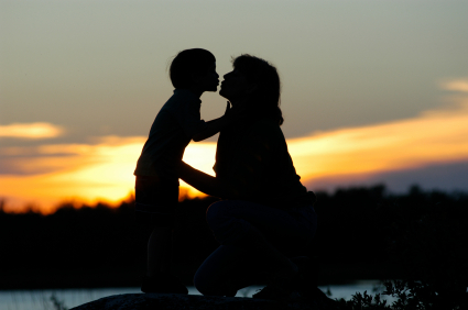 Mother and Infant Kissing at Sunset