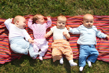 Four Babies Playing